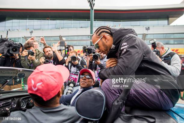 Lewis Hamilton of Mercedes and Great Britain with his Brother Nick and Father Anthony during the F1 Grand Prix of Great Britain at Silverstone on...