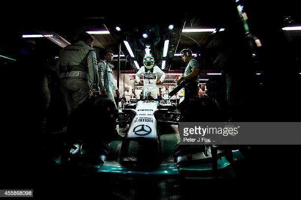 Lewis Hamilton of Merceds and Great Britain prepares for the Singapore F1 Grand Prix at Marina Bay Street Circuit on September 21 2014 in Singapore...