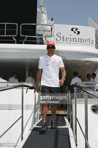 Lewis Hamilton of team McLaren Mercedes poses on a yacht in Monaco harbour after attending the launch of the Steinmetz diamonds that will be on the...