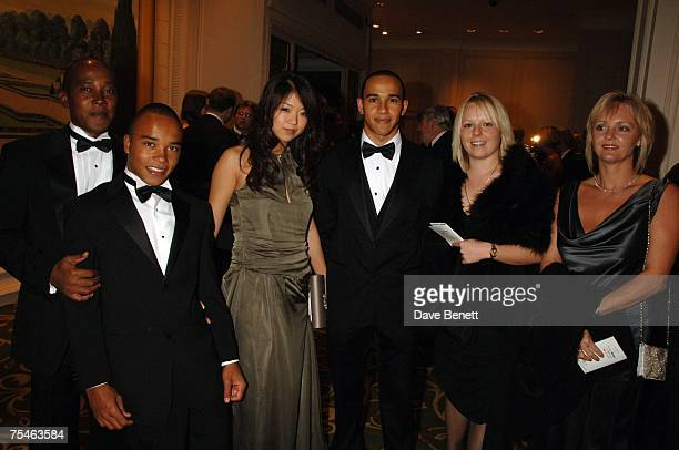 Lewis Hamilton poses with his girlfriend Jodia Ma his father Anthony Hamilton his brother Nicholas Hamilton at the AutoSport Magazine awards at the...