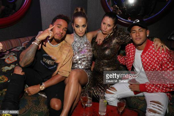 Lewis Hamilton Rita Ora Guest and Neymar attends the Miu Miu LOVE party at Loulou's on September 18 2017 in London England