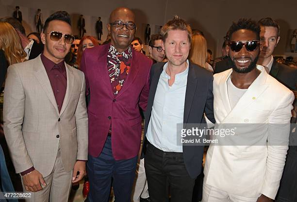 Lewis Hamilton, Samuel L. Jackson, Christopher Bailey, Burberry Chief Creative and Chief Executive Officer, and Tinie Tempah pose backstage at the...