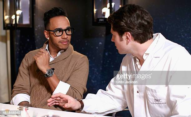 Lewis Hamilton visits the IWC booth during the Salon International de la Haute Horlogerie 2015 at the Palexpo on January 20, 2015 in Geneva,...