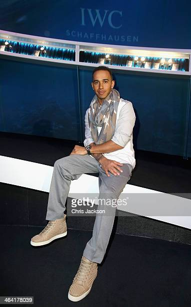 Lewis Hamilton visits the IWC booth during the Salon International de la Haute Horlogerie 2014 at the Palexpo on January 21, 2014 in Geneva,...