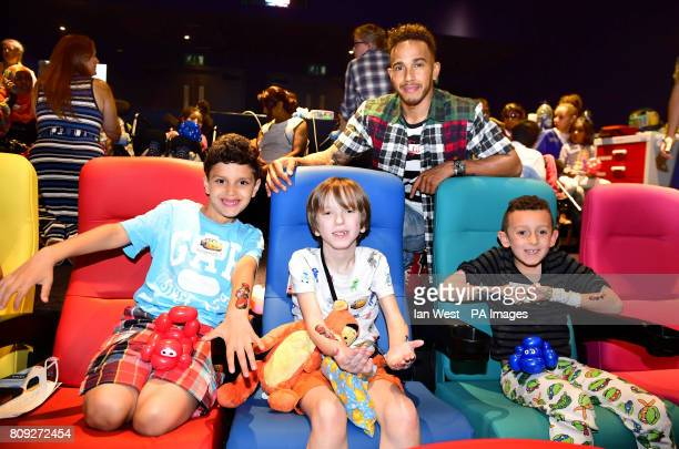 Lewis Hamilton with children including Albert during a special screening for Disney's Cars 3 at the Chelsea and Westminster Hospital in London