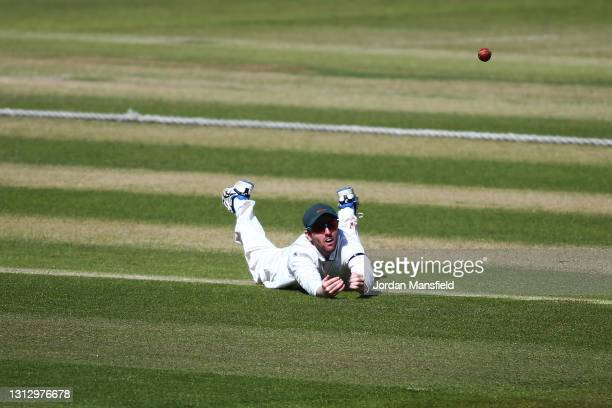 Lewis Hill of Leicestershire dives to field a ball during day three of the LV= Insurance County Championship match between Surrey and Leicestershire...