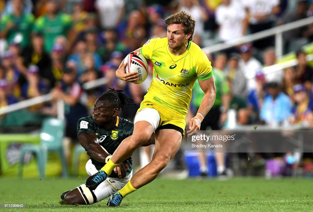 Lewis Holland of Australia breaks away from the defence in the MenÕs final match against South Africa during day three of the 2018 Sydney Sevens at Allianz Stadium on January 28, 2018 in Sydney, Australia.