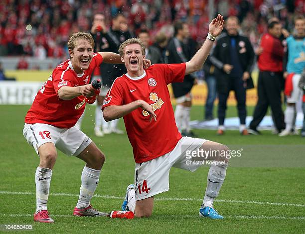 Lewis Holtby and André Schuerrle of Mainz celebrate the 42 victory after the Bundesliga match between FSV Mainz 05 and 1899 Hoffenheim at Bruchweg...