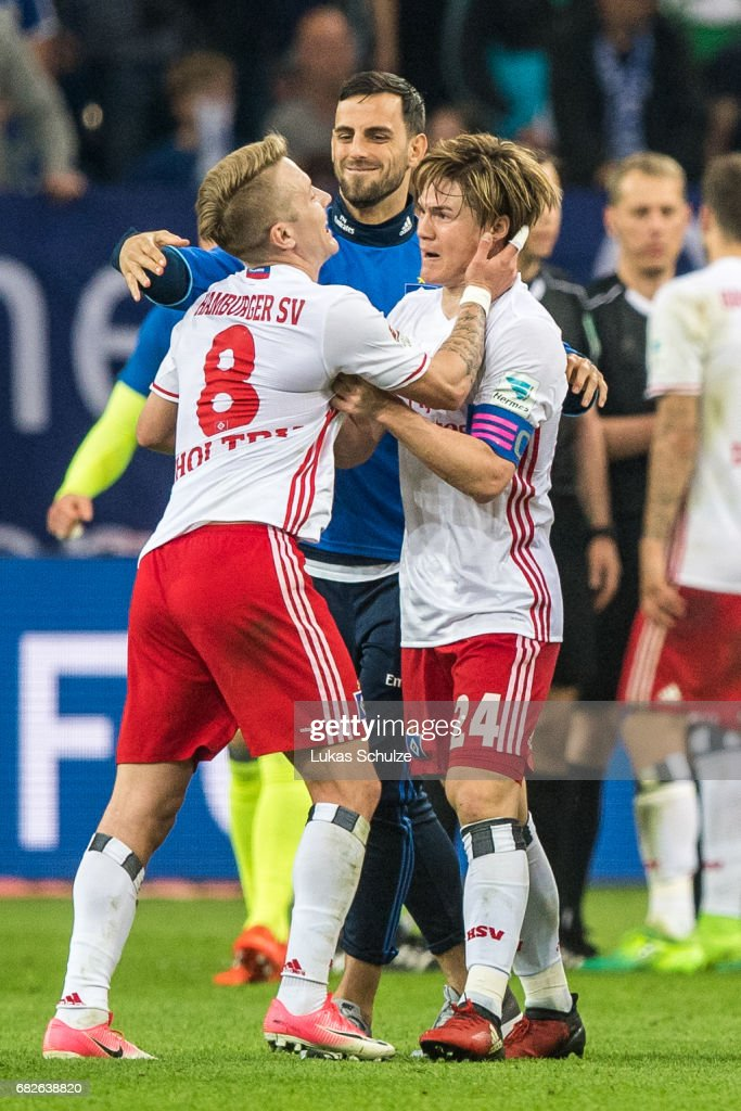 Lewis Holtby (L) and Gotoku Sakai (R) celebrate after the Bundesliga match between FC Schalke 04 and Hamburger SV at Veltins-Arena on May 13, 2017 in Gelsenkirchen, Germany.