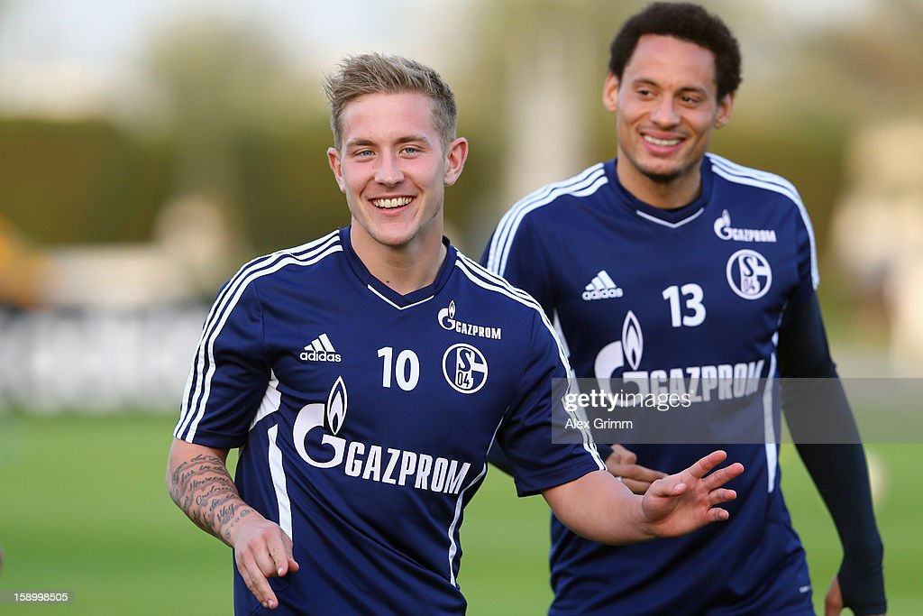 Lewis Holtby (front) and Jermaine Jones gesture during a Schalke 04 training session at the ASPIRE Academy for Sports Excellence on January 5, 2013 in Doha, Qatar.