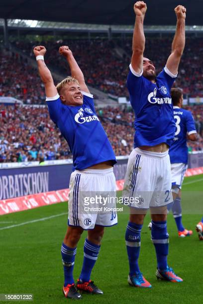 Lewis Holtby celebrates the second goal with Christian Fuchs of Schalke during the Bundesliga match between Hannover 96 and FC Schalke 04 at AWD...