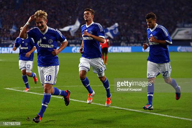 Lewis Holtby celebrates the second goal with Roman Neustaedter and Tranquillo Barnetta of Schalke during the Bundesliga match between FC Schalke 04...