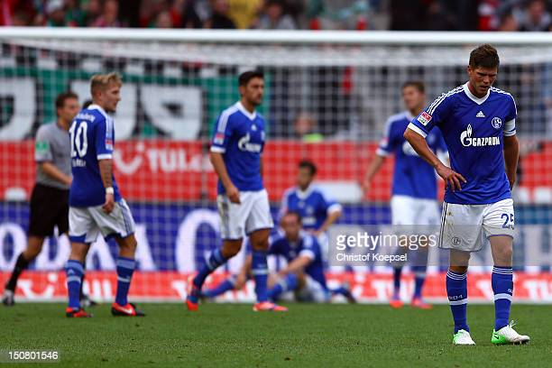 Lewis Holtby Ciprian Marica Roman Neustaedter and KlaasJan Huntelaar of Schalke look dejected after Hannover scored the second goal during the...