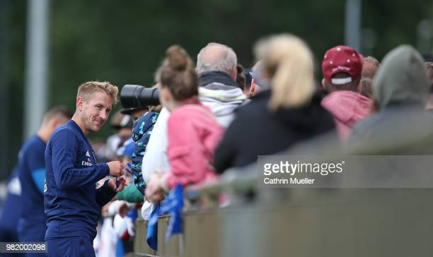 Lewis Holtby gives some autographs after the first training session of the new season at Volksparkstadion on June 23 2018 in Hamburg Germany...
