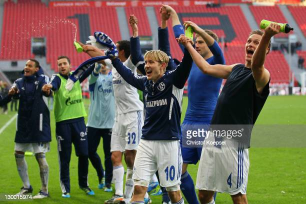 Lewis Holtby Lars Unnerstall and Benedikt Hoewedes of Schalke celebrate the 10 victory after the Bundesliga match between Bayer 04 Leverkusen and FC...