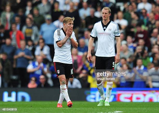 Lewis Holtby of Fulham looks dejected with Brede Hangeland of Fulham during the Barclays Premier League match between Fulham and Everton at Craven...