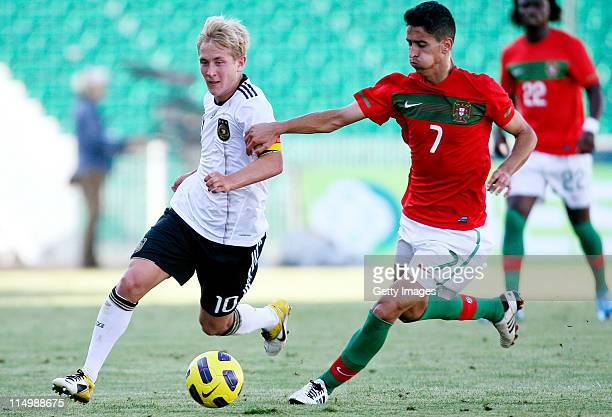 Lewis Holtby of Germany and Andre Almeida of Portugal fight for the ball during the U21 match between Portugal and Germany at Portimao stadium on May...