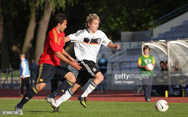 Lewis Holtby of Germany battles for the ball during the U19 Euro Qualifier match between Spain and Germany at the A Le Coq Arena on May 26 2009 in...