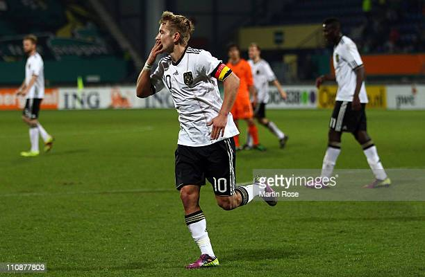 Lewis Holtby of Germany celebrates after he scores his team's 3rd goal during the U21 international friendly match between Germany and Netherlands at...