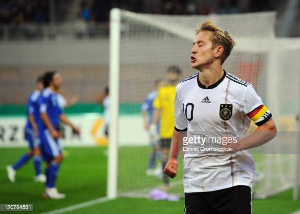 Lewis Holtby of Germany celebrates after scoring his team's second goal during the 2013 UEFA European Under21 Qualifier Group 1 match between Germany...