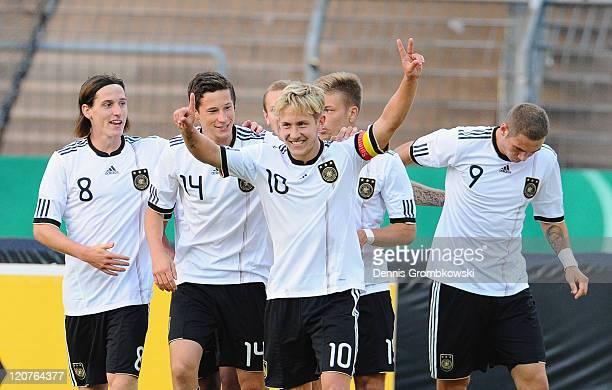 Lewis Holtby of Germany celebrates with his team mates Sebastian Rudy Julian Draxler Alexander Esswein and PierreMichel Lasogga after scoring his...