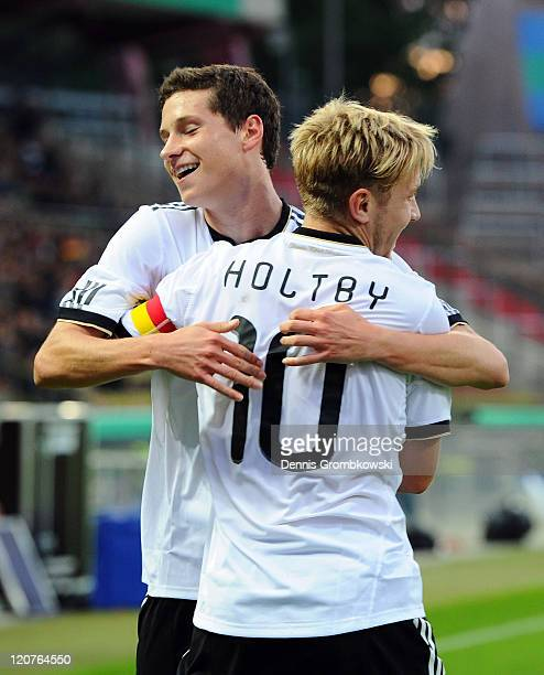 Lewis Holtby of Germany celebrates with team mate Julian Draxler after scoring his team's second goal during the 2013 UEFA European Under21 Qualifier...
