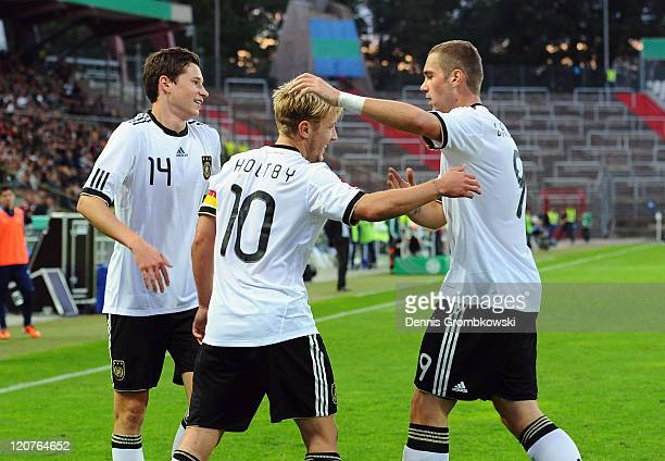 Lewis Holtby of Germany celebrates with team mates Julian Draxler and PierreMichel Lasogga during the 2013 UEFA European Under21 Qualifier Group 1...