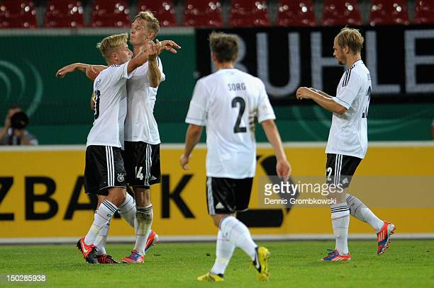 Lewis Holtby of Germany celebrates with teammates after scoring his team's second goal during the Under 21 international friendly match between...