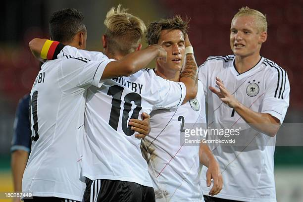 Lewis Holtby of Germany celebrates with teammates after scoring his team's fourth goal during the Under 21 international friendly match between...