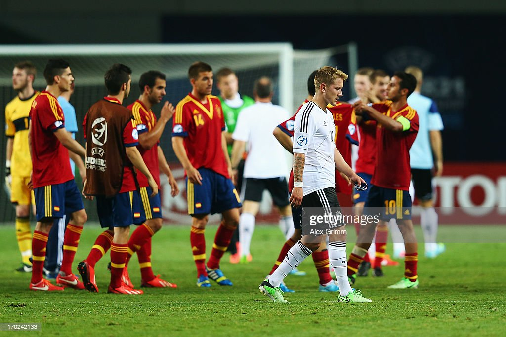 Lewis Holtby (front) of Germany walks past the Spanish players after the UEFA European U21 Champiosnship Group B match between Germany and Spain at Netanya Stadium on June 9, 2013 in Netanya, Israel.