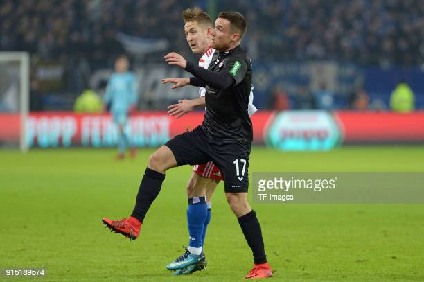 Lewis Holtby of Hamburg and Christian Clemens of Koeln battle for the ball during the Bundesliga match between Hamburger SV and 1 FC Koeln at...
