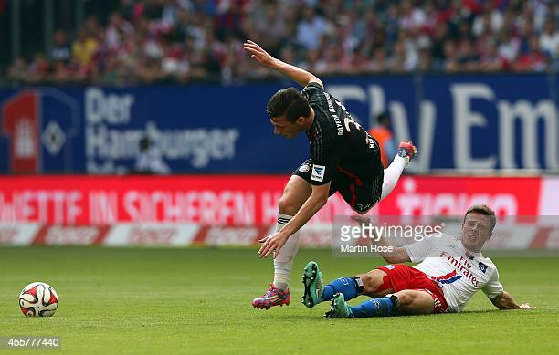 Lewis Holtby of Hamburg and Pierre Emile Hoejbjerg of Bayern Muenchen battle for the ball during the Bundesliga match between Hamburger SV and FC...