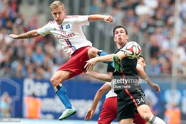 Lewis Holtby of Hamburg and Pierre Emile Hojbjerg of Munich compete for the ball during the Bundesliga match between Hamburger SV and FC Bayern...