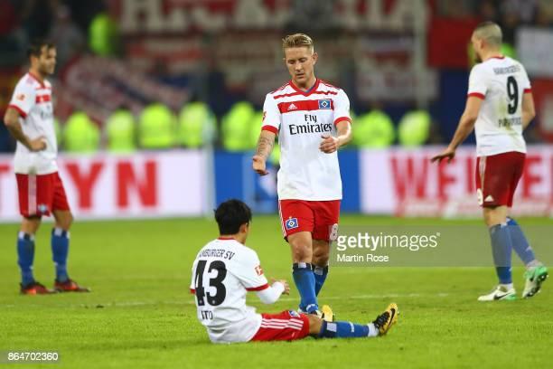 Lewis Holtby of Hamburg and Tatsuya Ito of Hamburg after the Bundesliga match between Hamburger SV and FC Bayern Muenchen at Volksparkstadion on...