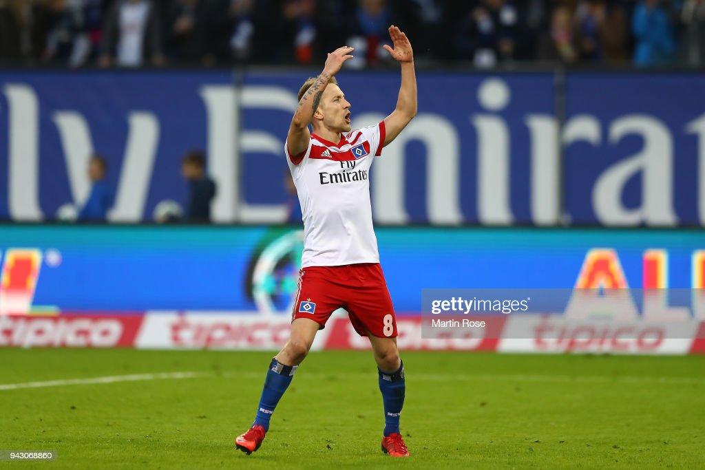 Lewis Holtby of Hamburg celebrates after he scored a goal to make it 2:1 during the Bundesliga match between Hamburger SV and FC Schalke 04 at Volksparkstadion on April 7, 2018 in Hamburg, Germany.