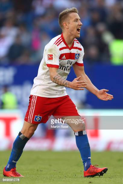 Lewis Holtby of Hamburg celebrates at the final whistle after the Bundesliga match between Hamburger SV and SportClub Freiburg at Volksparkstadion on...