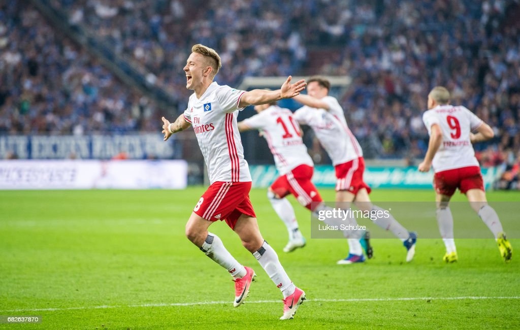 Lewis Holtby of Hamburg celebrates the teams first goal by Pierre-Michel Lasogga (2L) during the Bundesliga match between FC Schalke 04 and Hamburger SV at Veltins-Arena on May 13, 2017 in Gelsenkirchen, Germany.