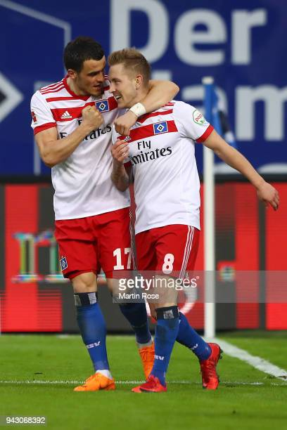 Lewis Holtby of Hamburg celebrates with Filip Kostic of Hamburg (l9 after he scored a goal to make it 2:1 during the Bundesliga match between...