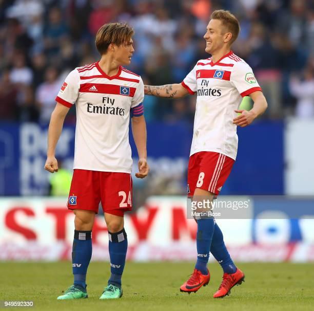 Lewis Holtby of Hamburg celebrates with Gotoku Sakaiof Hamburg at the final whistle after the Bundesliga match between Hamburger SV and SportClub...