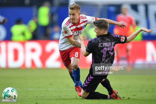Lewis Holtby of Hamburg fights for the ball with Lukas Kuebler of Freiburg during the Bundesliga match between Hamburger SV and SportClub Freiburg at...