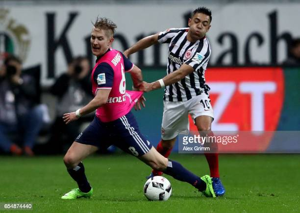 Lewis Holtby of Hamburg is challenged by Marco Fabian of Frankfurt during the Bundesliga match between Eintracht Frankfurt and Hamburger SV at...