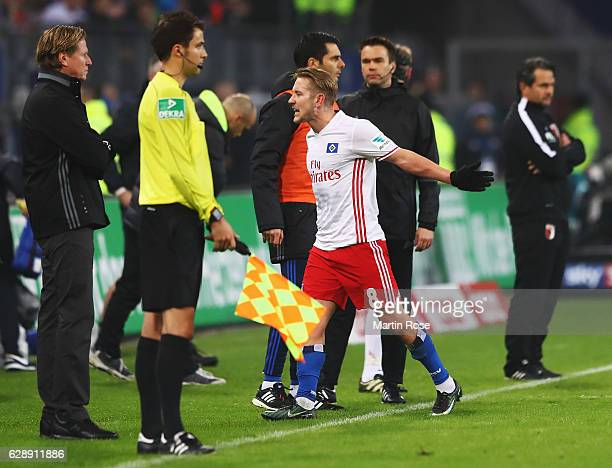 Lewis Holtby of Hamburg reacts after being shown the red card during the Bundesliga match between Hamburger SV and FC Augsburg at Volksparkstadion on...