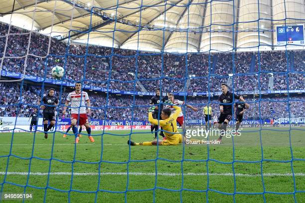 Lewis Holtby of Hamburg scores a goal past goalkeeper Alexander Schwolow of Freiburg to make it 10 during the Bundesliga match between Hamburger SV...
