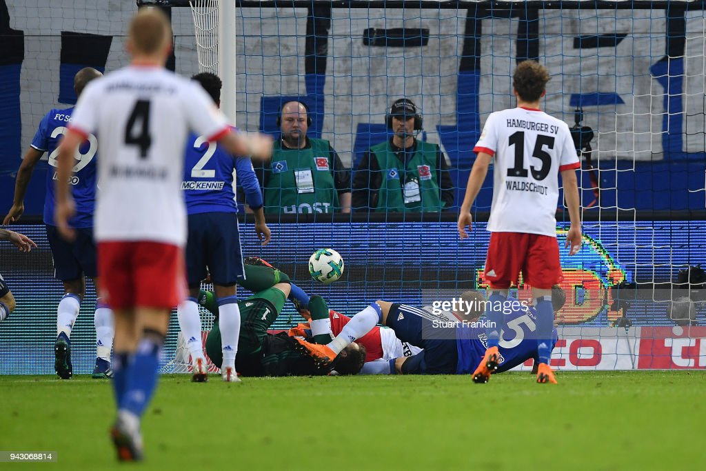 Lewis Holtby of Hamburg (8, on pitch) scores a goal to make it 2:1 during the Bundesliga match between Hamburger SV and FC Schalke 04 at Volksparkstadion on April 7, 2018 in Hamburg, Germany.