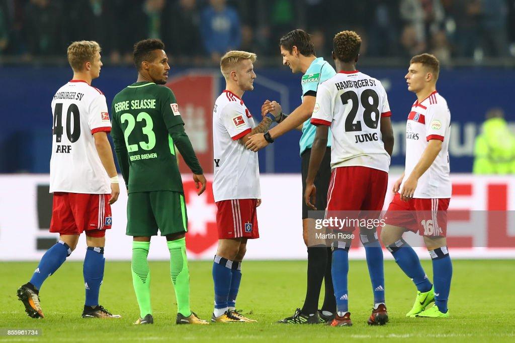 Lewis Holtby of Hamburg (l) shakes hands with referee Deniz Aytekin during the Bundesliga after between Hamburger SV and SV Werder Bremen at Volksparkstadion on September 30, 2017 in Hamburg, Germany.