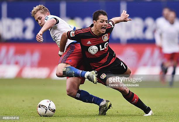 Lewis Holtby of Hamburger SV and Chicharito of Bayer Leverkusen battle for the ball during the Bundesliga match between Hamburger SV and Bayer...