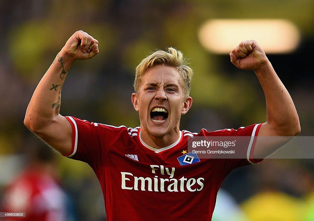 Lewis Holtby of Hamburger SV celebrates victory after the Bundesliga match between Borussia Dortmund and Hamburger SV at Signal Iduna Park on October 4, 2014 in Dortmund, Germany.