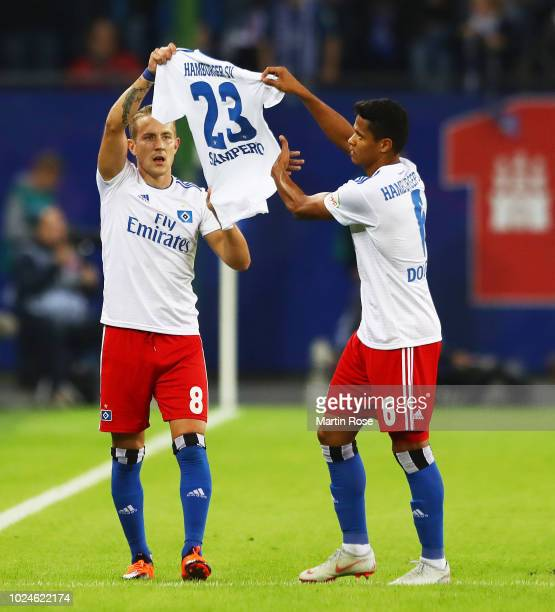 Lewis Holtby of Hamburger SV holds up a Jairo Samperio shirt with Douglas Santos of Hamburger SV after scoring the first goal the Second Bundesliga...