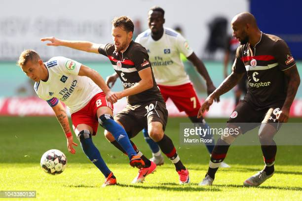 Lewis Holtby of Hamburger SV is challanged by Christopher Buchtmann of FC St Pauli and Christopher Avevor of FC St Pauli during the Second Bundesliga...