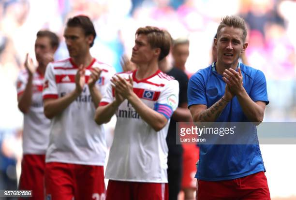 Lewis Holtby of Hamburger SV shows appreciation to the fans after his team is relegated after the Bundesliga match between Hamburger SV and Borussia...